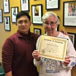 jersey city physical therapist humberto colmenares with knee back pain patient miriam