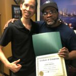jersey city physical therapist dr. james pumarada with jerry, a happy complete physical rehabilitation back pain patient